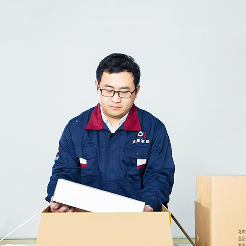 worker packing in stock classical cutlery
