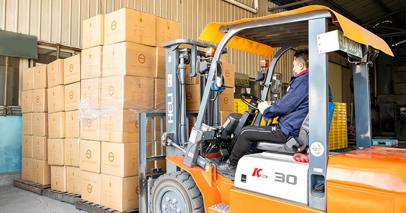 worker using forklift to get package deliver ready